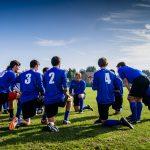 soccer-coach-team-huddle