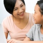 mother talking to daughter about school
