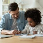 dad helping daughter with schoolwork
