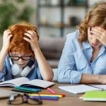 Mother is stressed while helping son with homework