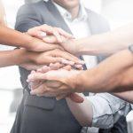 business partnerships - hands in - teamwork